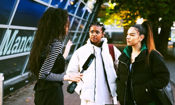 Mari interviewing students in Manchester, England in 2018 about what they want in a video streaming platform.